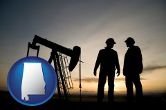alabama map icon and an oil well and two oil workers at dusk