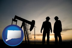 connecticut map icon and an oil well and two oil workers at dusk