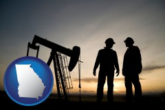 georgia map icon and an oil well and two oil workers at dusk