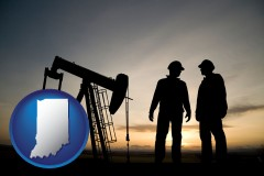 indiana map icon and an oil well and two oil workers at dusk