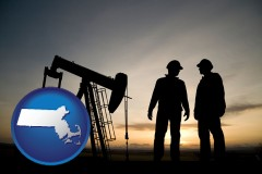 massachusetts map icon and an oil well and two oil workers at dusk