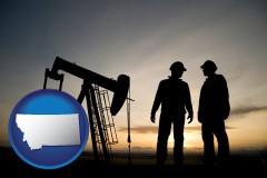 montana map icon and an oil well and two oil workers at dusk