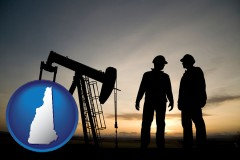 new-hampshire map icon and an oil well and two oil workers at dusk
