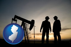 new-jersey map icon and an oil well and two oil workers at dusk
