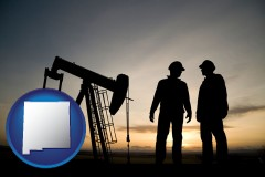 new-mexico map icon and an oil well and two oil workers at dusk
