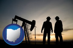 ohio map icon and an oil well and two oil workers at dusk