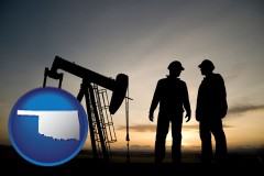 oklahoma map icon and an oil well and two oil workers at dusk