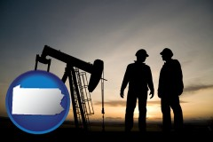 pennsylvania map icon and an oil well and two oil workers at dusk