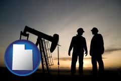 utah map icon and an oil well and two oil workers at dusk