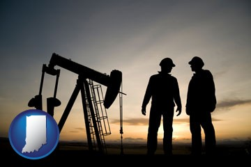 an oil well and two oil workers at dusk - with Indiana icon
