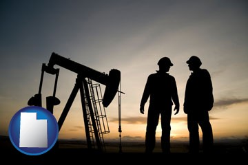 an oil well and two oil workers at dusk - with Utah icon